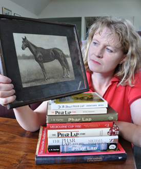 Phar Lap fan: Robin Marshall with the 1930s image of Phar Lap and her books on the champion thoroughbred.