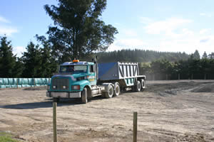 The base course arrives: 17 truckloads of AP65.