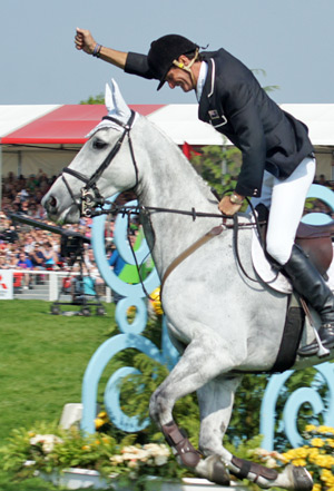 Mark Todd punches the air after his winning clear round on Land Vision at Badminton last year.