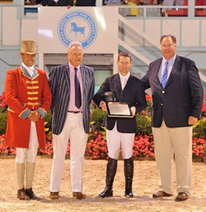 McLain Ward is joined in the winner's circle by THIS' Michael Taylor and William Weeks after he won the first leg of the $200,000 Taylor Harris Triple Crown Challenge by taking the Wells Fargo Grand Prix of Devon.  © Parker/Russell - The Book LLC.