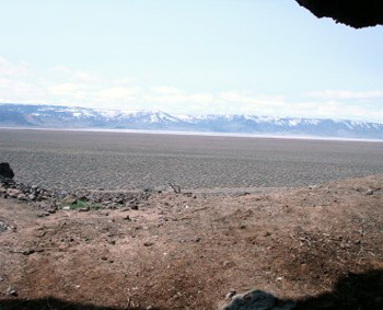 Looking out from inside the Paisley Caves, over the ancient lake bed to the west with the Cascade Range in the background.