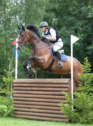 Trevor Breen and Adventure De Kannan on their way to winning the Amlin Plus Eventing Grand Prix at Hickstead.
