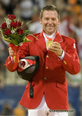 Eric Lamaze celebrates his Individual Gold Medal in show jumping at the 2008 Olympic Games in Hong Kong.