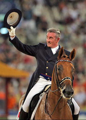 Hubert Perring of France and Diabolo St Maurice salute the crowd after performing their test during the Dressage Individual Grand Prix Special held at the Hong Kong Olympic Equestrian Venue in Sha Tin during day 8 of the Beijing 2008 Olympic Games on 16 August 2008 in Hong Kong, China.