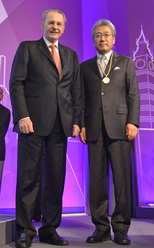 Newly elected IOC member Tsunekazu Takeda, right, with IOC President Jacques Rogge at the 124th IOC Session in London.