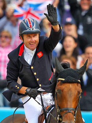 Peter Charles of Great Britain celebrates a clear round on Vindicat W in the jump-off against the Netherlands to help secure the gold.
