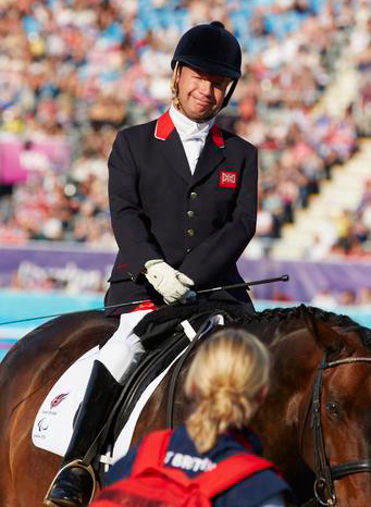 Britain's Lee Pearson on Gentleman after winning Grade Ib freestyle bronze.