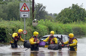 Davy and Noah are guided to safety by the rescue team.