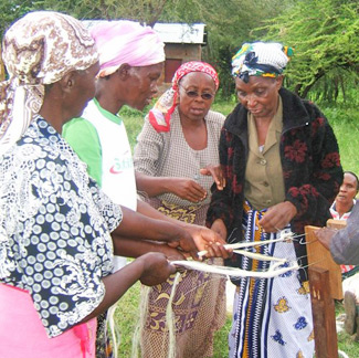 Women in Makueni with the rope making machine.