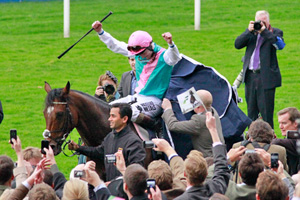 Jockey Tom Queally celebrates on Frankel after their Champion Stakes win.