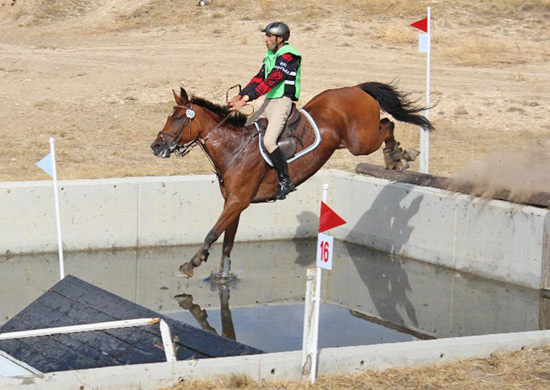 Bulgaria's Ivan Dobrev and Nikita tackle the water complex on Pierre Michelet's Cross Country course en route to individual gold at the FEI Balkan Eventing Championship in Eskisehir (TUR).