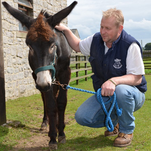 Rescued donkey Rupert with Chris Pile, manager of the Derbyshire centre.