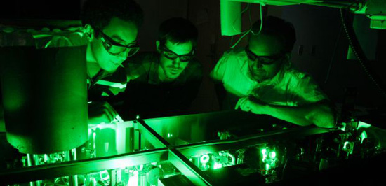 UA physicists led by Arvinder Sandhu (right) take advantage of the world's fastest laser pulses to take snapshots of ultrafast processes such as chemical reactions.