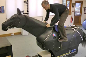 a jockey using a racehorse simulator
