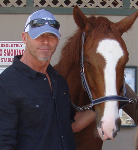 Richard Couto and a young thoroughbred he rescued, Freedom's Flight.