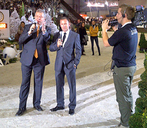 Eric Lamaze (right) gives a course description to the audience with Alban Poudret at CSI5*-W Geneva, Switzerland.