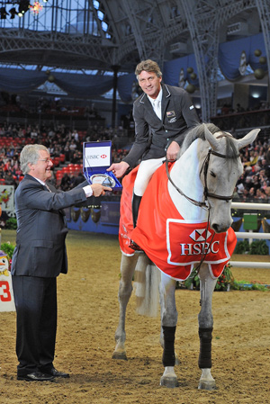 HSBC rankings leader Andrew Nicholson was presented with his prize by FEI First Vice President John McEwen at Olympia on Sunday.
