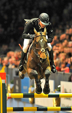 The Netherlands' Marc Houtzager and Sterrehof's Tamino galloped to victory in the seventh leg of the Rolex FEI World Cup™ Jumping 2012/2013 Western European League series at London, Olympia (GBR) today.  Photo: FEI/Kit Houghton.