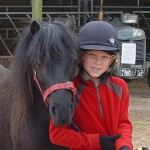 Henry with his favourite DPHT Adoption pony, Smartie.