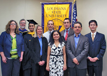 Attending the Diploma Distribution Ceremony at the LSU School of Veterinary Medicine are (from left) Dr. Cathryn Stevens-Sparks, Dr. George Strain, Dr. Jorge Vila, Dr. Sara Lyle, Dr. Romain Pariaut, Sona Chowdhury, Dr. David Beehan, Dr. Konstantin Kousoulas and Shiliang Anthony Liu.