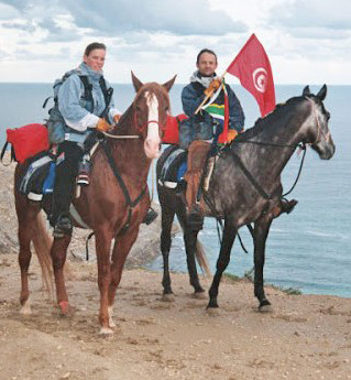 "At the beginning of the journey, in Cap Blanc, Tunisia. Prior to their departure, Christy wrote, ""The first reason for our ride is pure adventure! We want to meet everyone, learn their cultures, languages, religions and way of life. We want people to understand that they can do anything they put their mind to."""