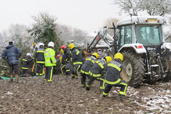 Firefighters used ropes, harnesses, a tractor, and a digger in the rescue.