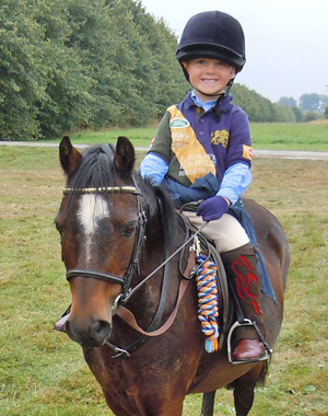 Young Harry Mundy, 5, had a great time on the Burghley Sponsored Ride in 2011.
