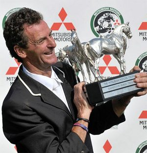 2011 winner Mark Todd with the Badminton trophy.