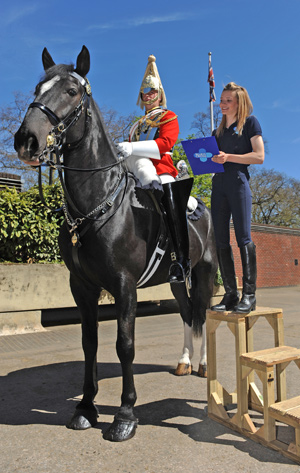 Blue Cross Groom Grace Shayler inspects Lance Corporal Francois Raats and his charger Colossus of the Queens Life Guards during the Blue Cross National Equine Health Survey (NEHS) at Hyde Park Barracks, London.