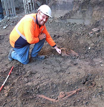 Matt Hennessey inspects the  horse skeleton found under the Isaac Theatre Royal. Photo: Underground Overground Archaeology