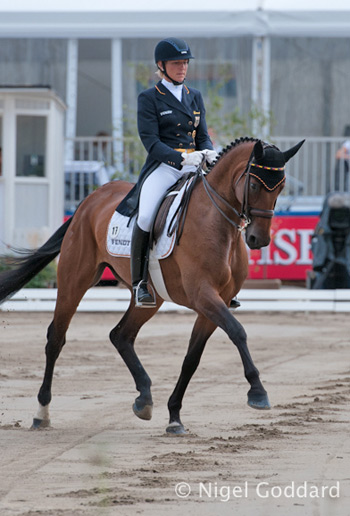 German team members Ingrid Klimke and FRH Escada JS lead after the first day of dressage.