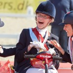 Grade 1a Freestyle gold medalist Sophie Christiansen, centre, celebrates with compatriot Anne Dunham (left) who took silver and bronze medalist Sara Morganti at the JYSK FEI European Para-Dressage Championships.