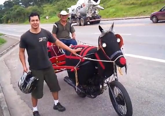 The motorcycle cameraman poses with the driver of the motorized buggy, believed to be João Dias, on the roadside in Sao Paulo, Brazil.