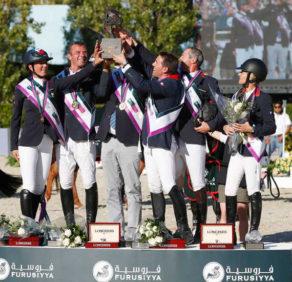 The winning French team of, from left, Pénélope Leprevost, Aymeric de Ponnat, Chef d'Equipe Philippe Guerdat (partially obscured), Simon Delestre, Patrice Delaveau and Eugenie Angot.