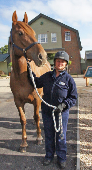 Poppy, pictured with Metropolitan Police Horse Trainer Jo Sullivan, is back on the beat in London.
