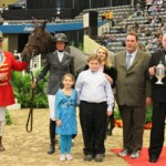 Hillary Simpson and Arkansas joined by owners the Kogen family at the presentation for Leading Thoroughbred at the Alltech National Horse Show.