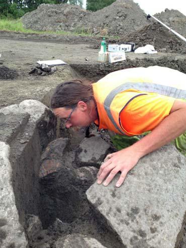 Archaeologist Jonas Wikborg inspects one of the pits. Photo: Kristina Ekero Eriksson