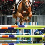McLain Ward and Rothchild charge over the GroupBy oxer to take the $100,000 Hickstead FEI World Cup Grand Prix on Wednesday night at Canada's Royal Horse Show. Ward also took the afternoon's $15,000 McKee Family International Jumper Challenge aboard Wings.