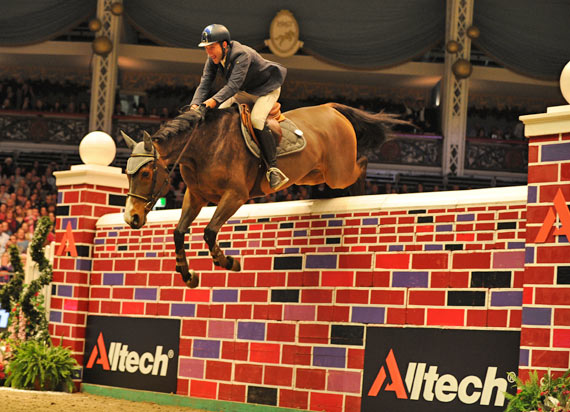 "Luca Moneta and Quovo de Vains clear 7'2"" to win the puissance at Olympia."