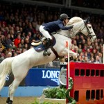Maikel Van der Vleuten and VDL Groep Sapphire B on their way to winning the World Cup class at Olympia.