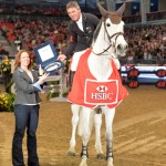 Andrew Nicholson is presented with a silver salver by HSBC Sponsorship Manager Kate Fullam at Olympia, after he ended the 2013 season as leader of the HSBC Rankings.
