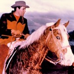 Elvis Presley and his favourite horse, Rising Sun.