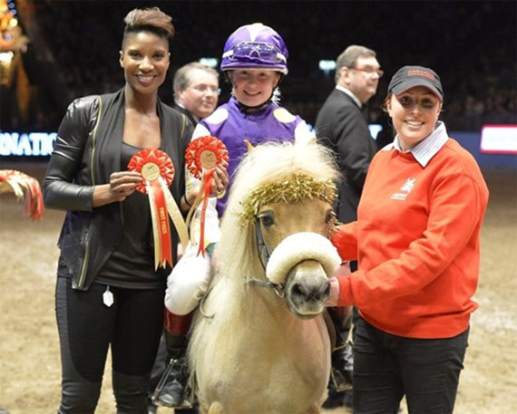Denise Lewis presents the prize to the winners of the Shetland Grand National, Greta Dare and 'Ulverscroft Dandi'.