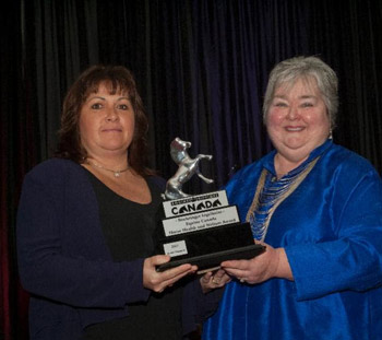 Brenda Thompson of  Whispering Hearts Horse Rescue is presented with the Equine Canada Horse Health and Welfare Award by Jan Stephens, past member of the Equine Canada Board, and past chair of the Stewards Committee.