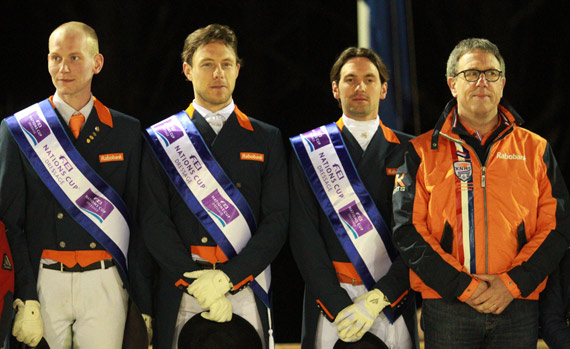 The Netherlands team of Diederik van Silfhout, Laurens van Lieren and Tommie Visser with Chef d'Equipe Wim Ernes on the top step of the podium following their victory at the second leg of the FEI Nations Cup Dressage 2014 pilot series at Vidauban, France, on Friday night.