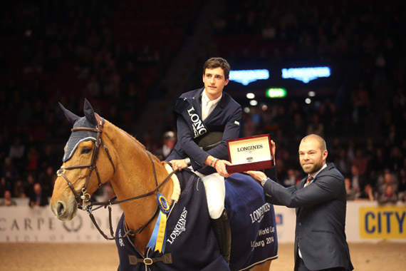 Kalle Sternberg, Brand Manager for Longines, Sweden, presents a Longines watch to Nicola Philippaerts after the young Belgian rider won the last qualifying round of the World Cup's Western European League at Gothenburg, Sweden.