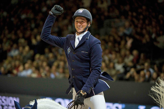 Daniel Deusser celebrates his victory with Cornet d'Amour.