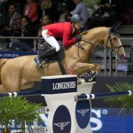 Switzerland's Pius Schwizer steered Quidam du Vivier to victory in the opening round of the Longines FEI World Cup Jumping Final at Lyon.