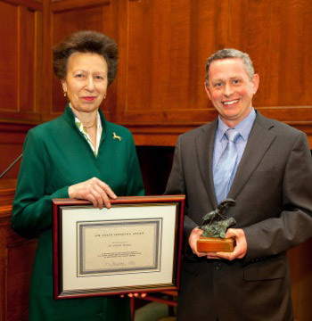 Dr Andrew Waller, Head of Bacteriology at the Animal Health Trust receives the NEF commendation from HRH The Princess Royal, President of the National Equine Forum.