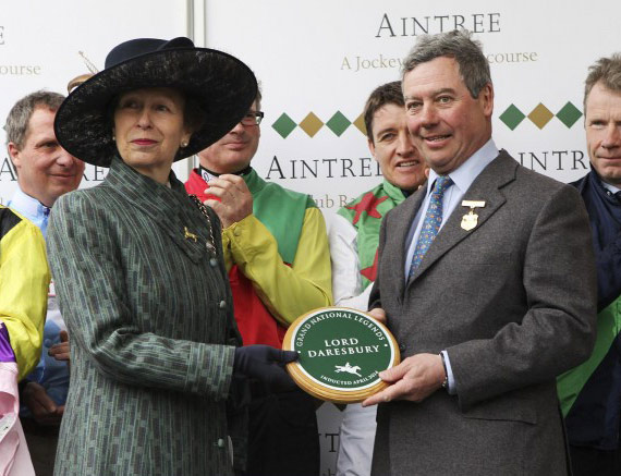 Princess Anne presents Lord Daresbury with a plaque inducting him into the Grand National Hall Of Fame.